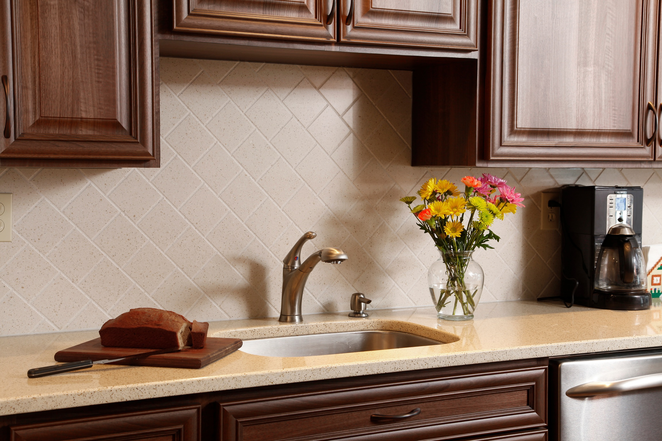 kitchen with full, routed Corian backsplash