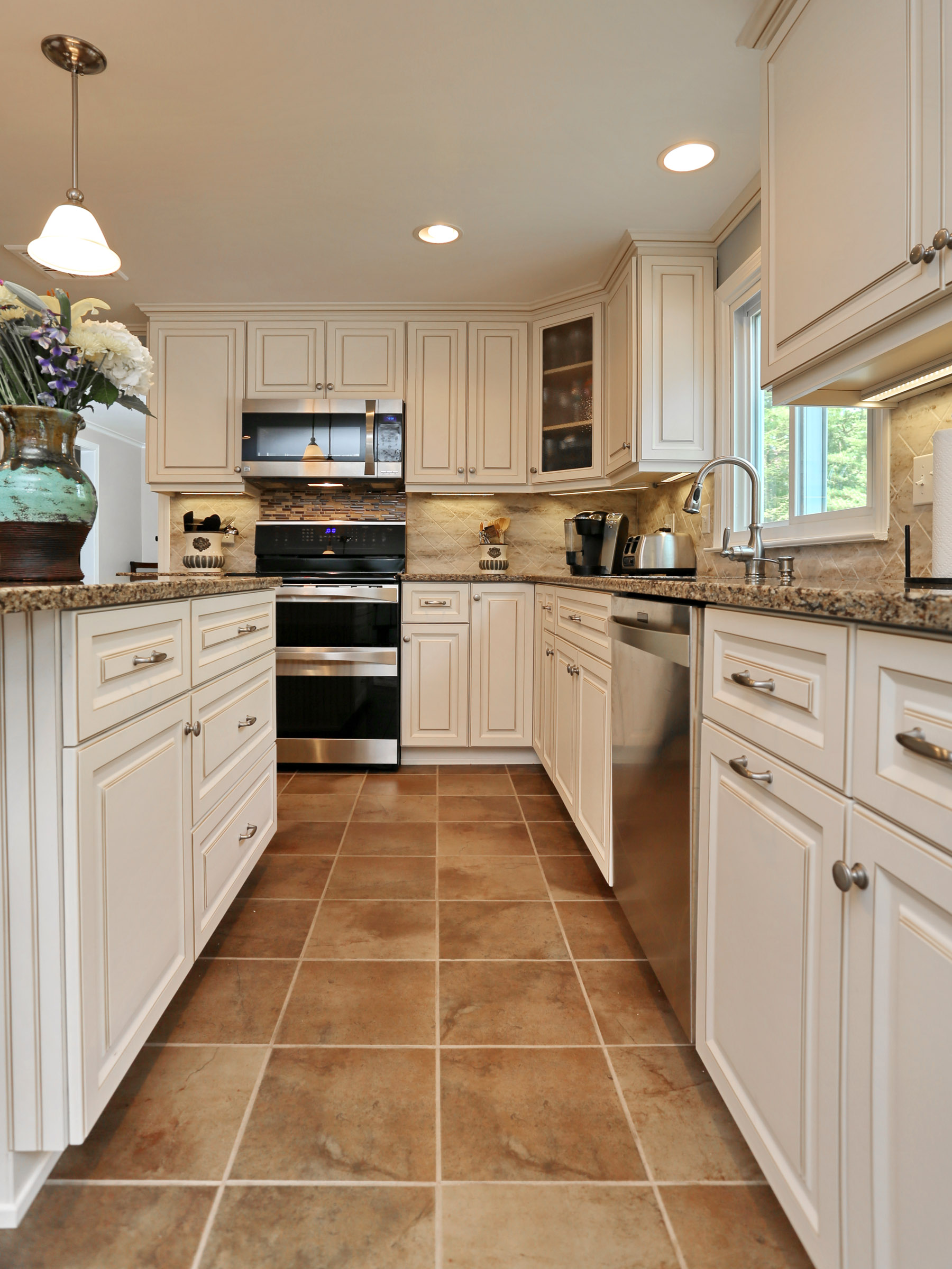 Cambria Canterbury countertops and Antique White cabinets