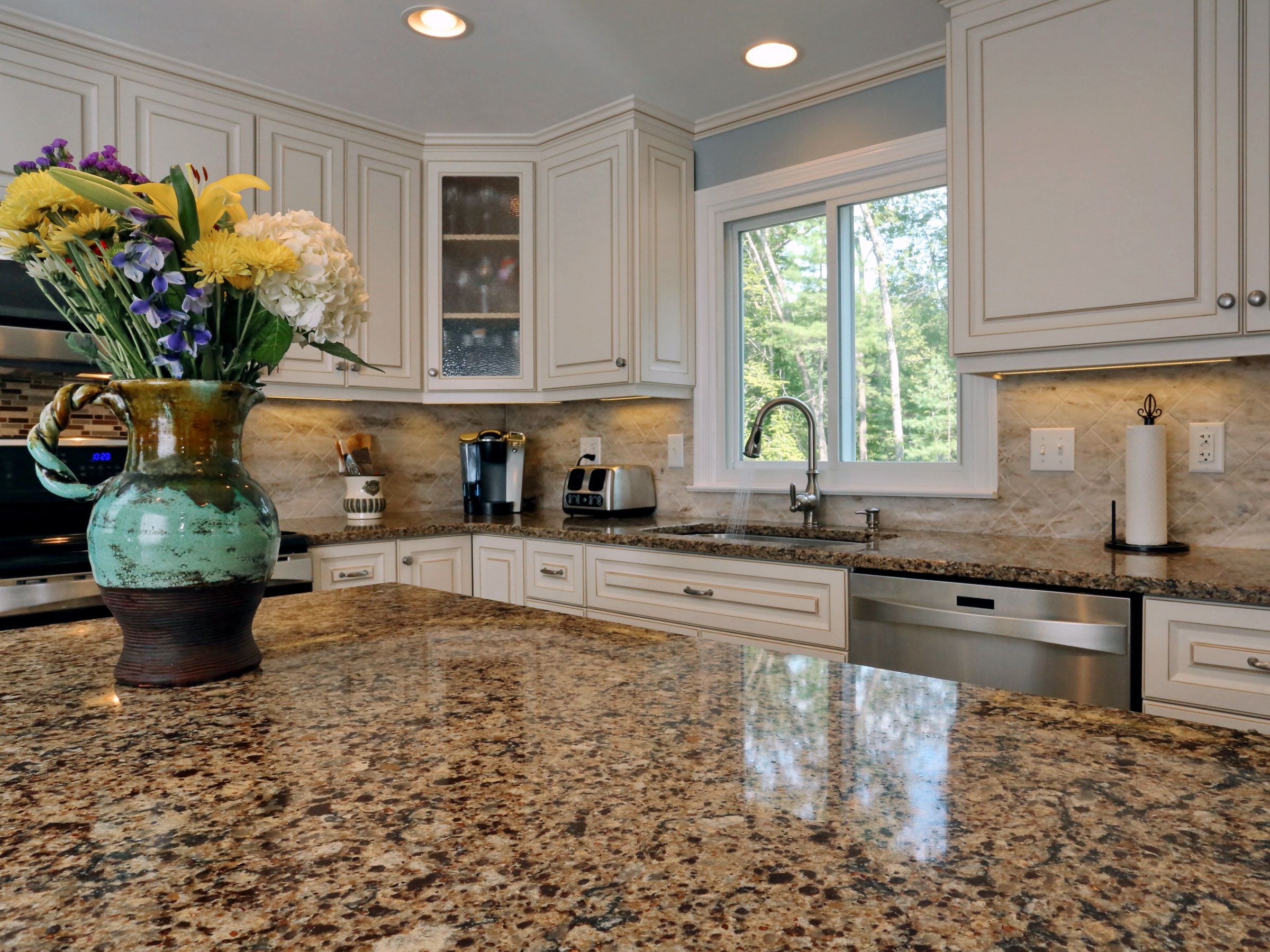 Cambria Canterbury countertop and Antique White cabinets