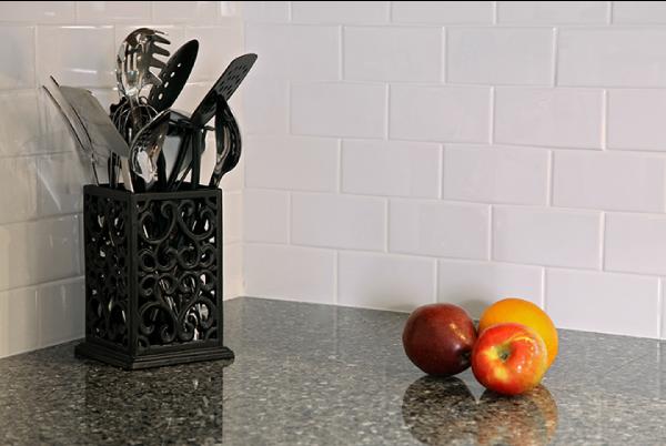 cambria quartz countertop and tile backsplash