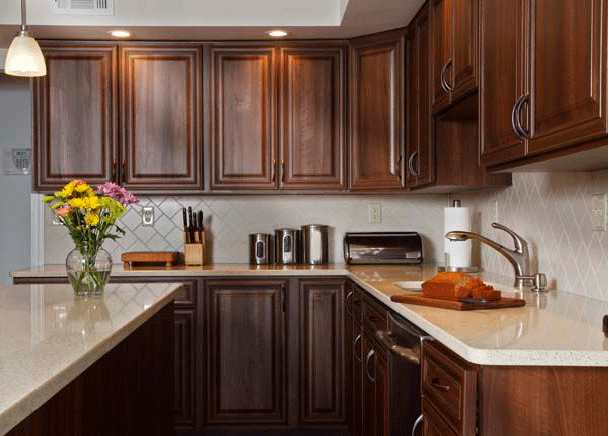 Ordinaire Walnut Cabinets With Light Countertop