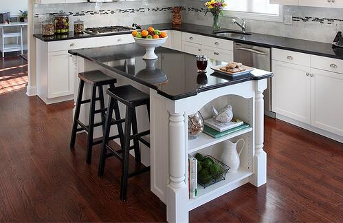 black quartz countertop in white kitchen