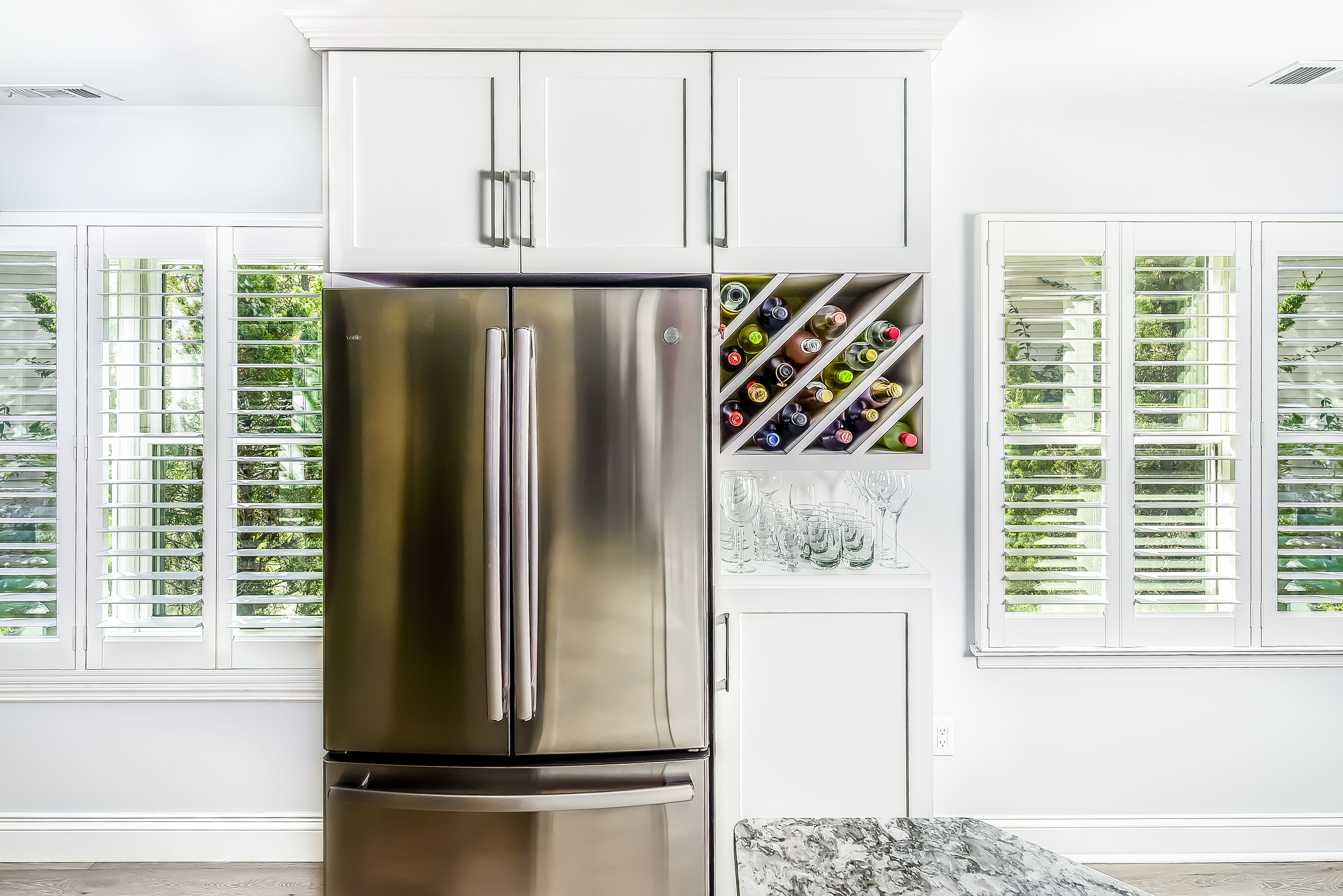 White Cabinetry and Steel appliance