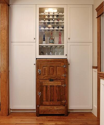 Wooden Antique Ice-Box in a White Cabinet Kitchen