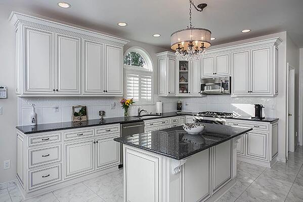 Traditional Chandelier in White Kitchen