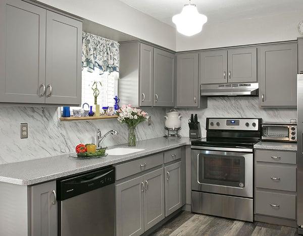 Cool Gray Kitchen Cabinets, Countertop, and Backsplash.