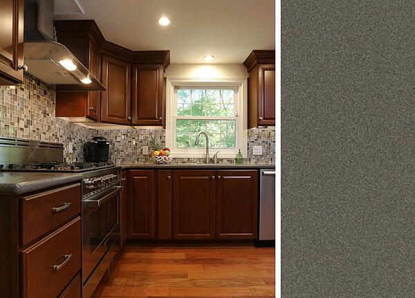 Dark Cabinets with a Gray Corian Countertop
