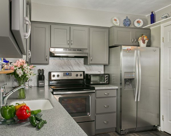 Dark gray kitchen cabients and countertop