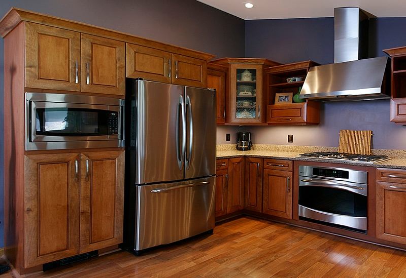 Stainless Steel French Door Drawer Fridge in a Kitchen with Wood Cabinets
