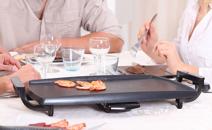 Cooking on Electric Griddle on Dining Table