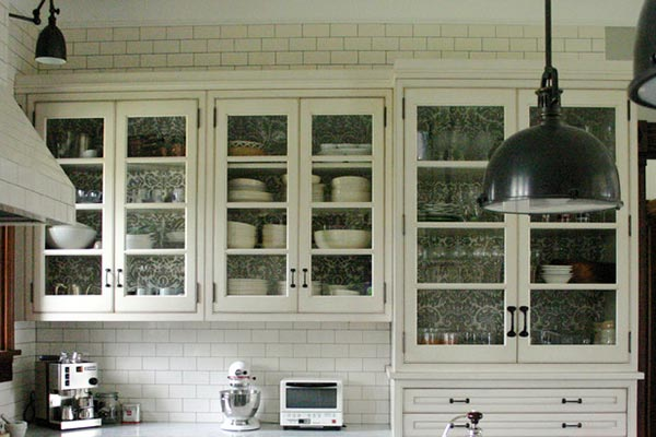 Glass Cabinets with Decorative Liner Behind