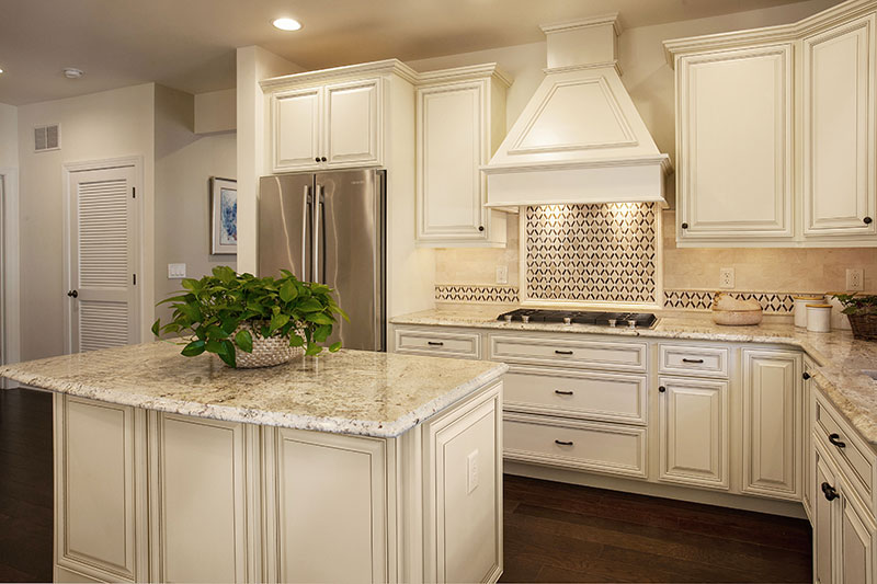 Creamy White Kitchen Cabinets with Coffee Glaze