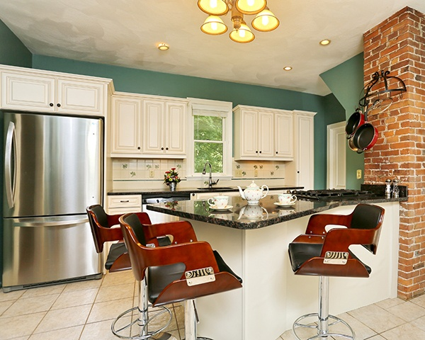 Green Kitchen with White Cabinets