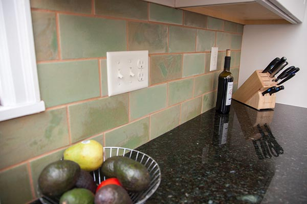 Green subway tile kitchen backsplash