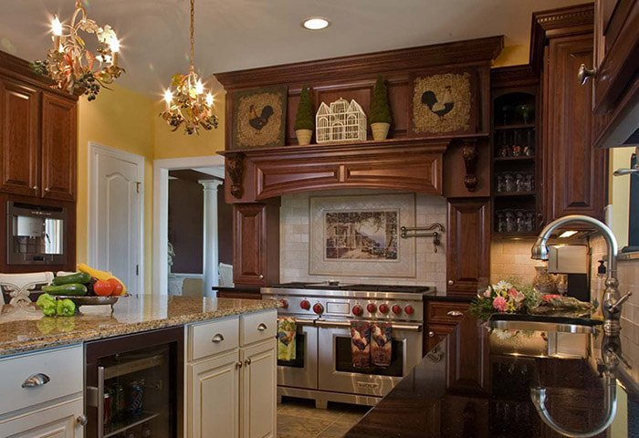 Traditional Kitchen With Wood Trim and Hearth Detailing