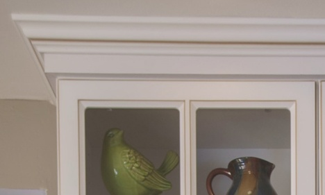 White Window-Front Curio Kitchen Cabinet with Ogee Crown Molding