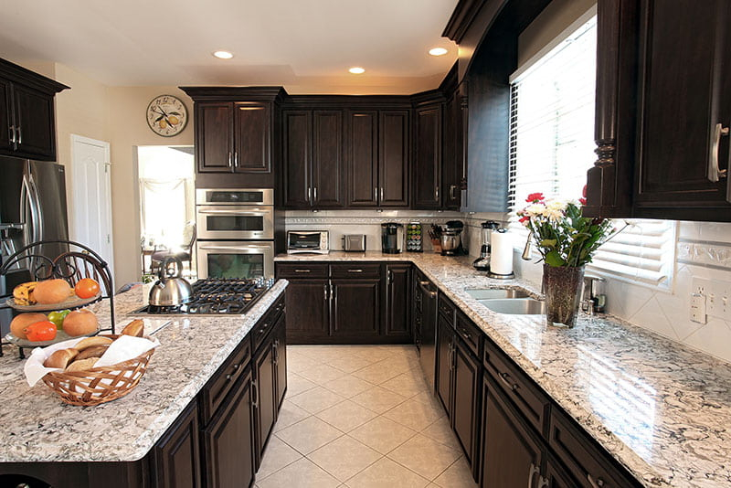 Attractive Dark Cabinets With Quartz Countertops