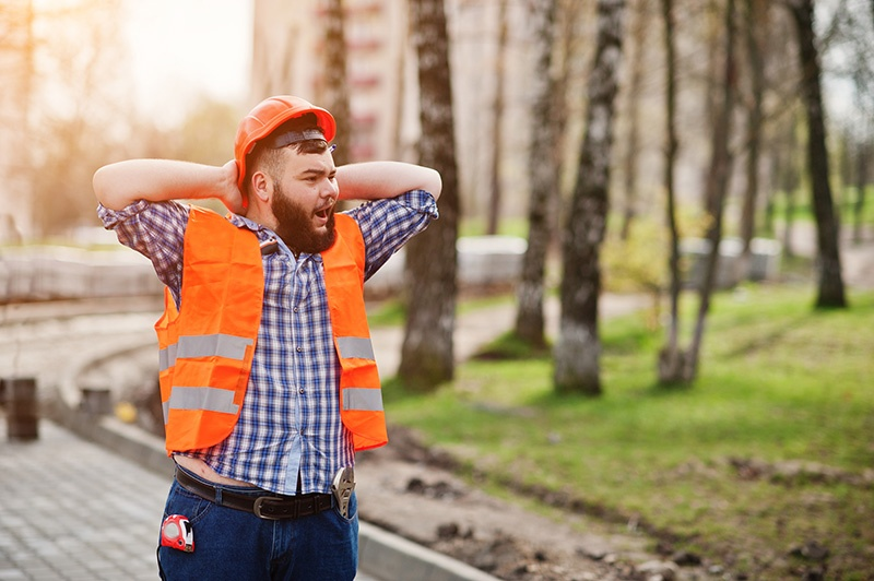 Contractor Yawning and Walking Away From the Job