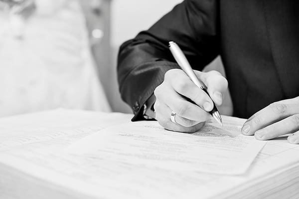 Man Forging Signature