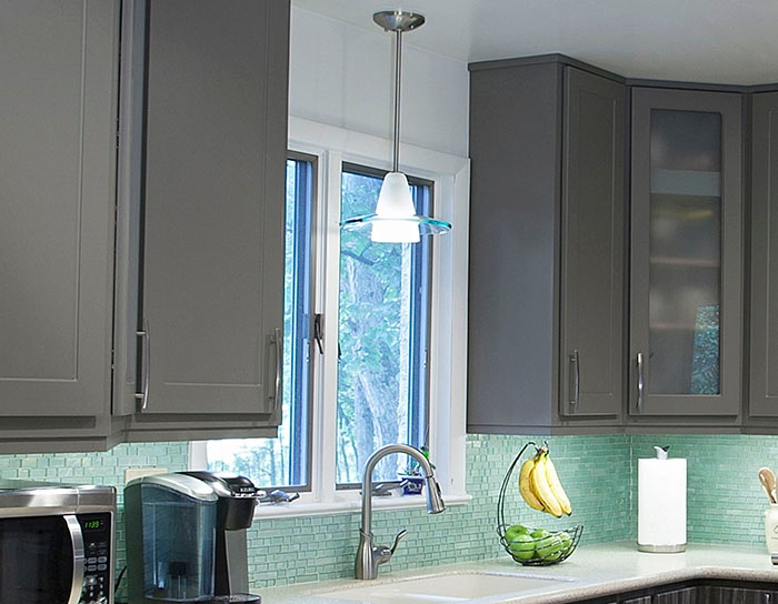 Gray Kitchen with Green Backsplash and Pendant Light