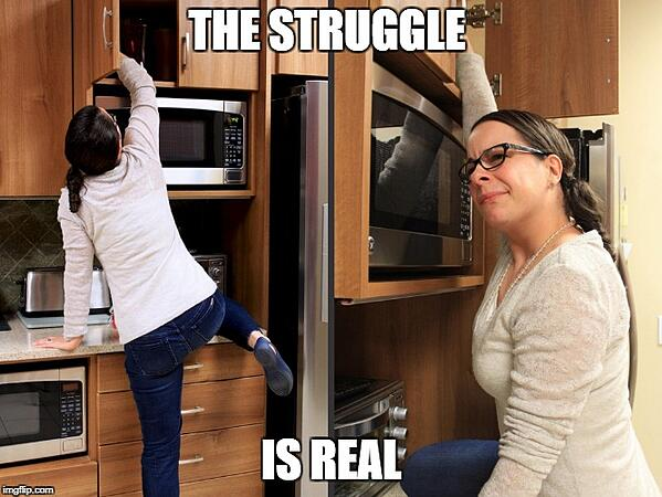 Woman Struggling to Reach Items in a High Kitchen Cabinet