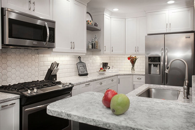 what countertop color looks best with white cabinets rh blog kitchenmagic com White Kitchen Cabinets with Granite Counters White Kitchen Dark Cabinets with Granite