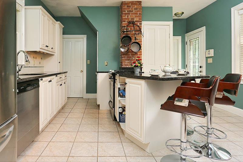 Green Wall Color and White Kitchen Cabinets