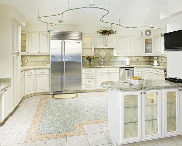 Bright White Kitchen with Stainless Steel Fridge