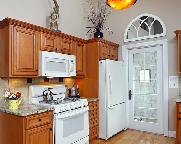 Wood Cabinet Kitchen with White Appliances and Accents