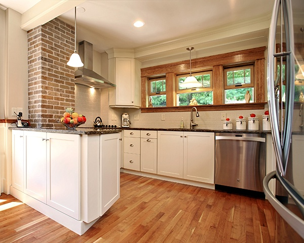 Kitchen with White Cabinets with Warm Colored Details