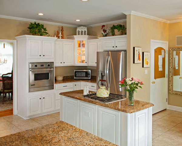 Spacious Kitchen with White Cabinets and an Island
