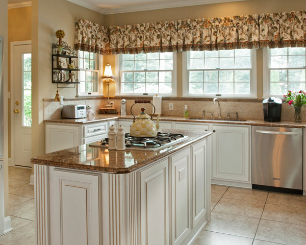 Cottage Style Kitchen with White Cabinets, Granite Countertop, and Yellow Tea Kettle