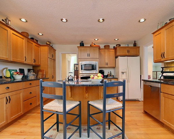 Fruitwood Stain on Maple Wood Kitchen Cabinets by Kitchen Magic