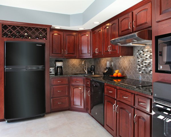Black Top-Freezer Fridge in Kichen with Cherry Cabinets
