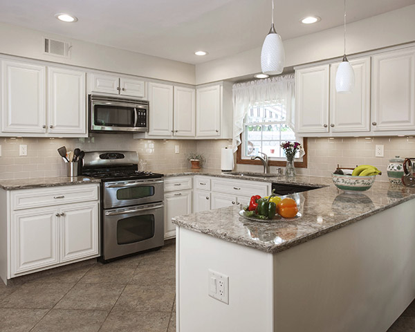 white kitchen cabinets with quartz countertop