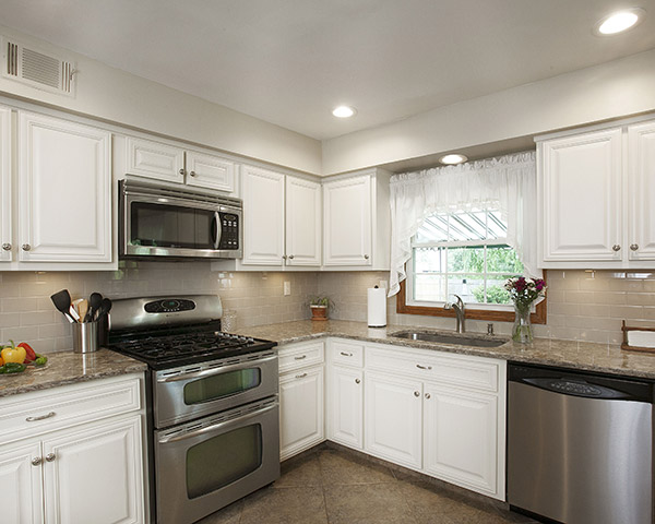 Remodeled Kitchen with Antique White Cabinets and Quartz Countertops