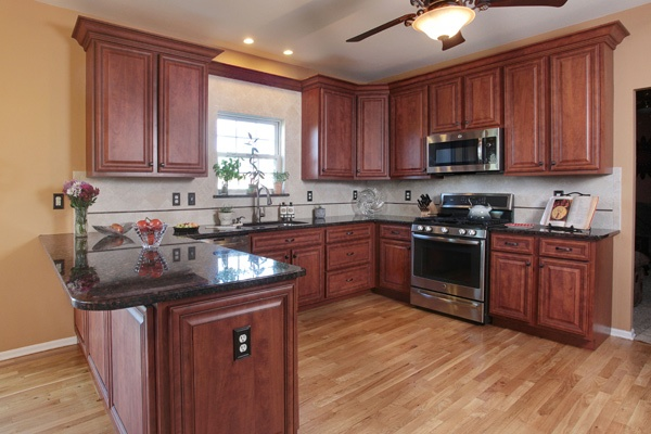 Cherry Cabinets With Black Countertops