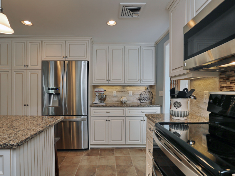 our popular antique white cabinets with walnut glaze