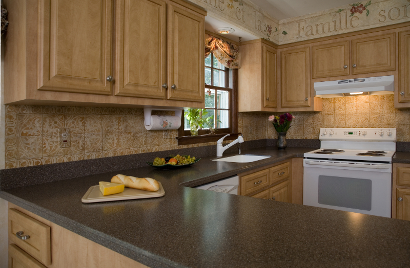 Kitchen With Maui Corian Countertop In Focus