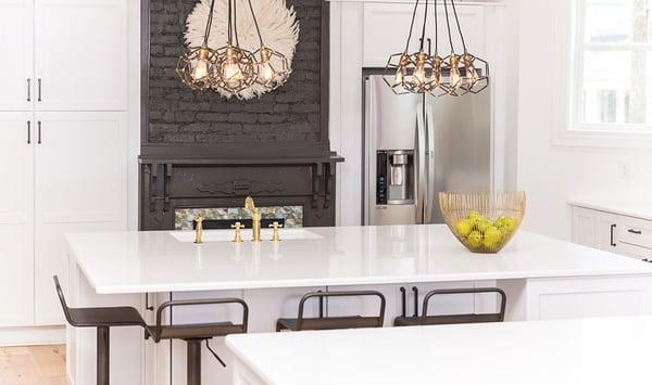 Hanstone quartz counter with white cabinets