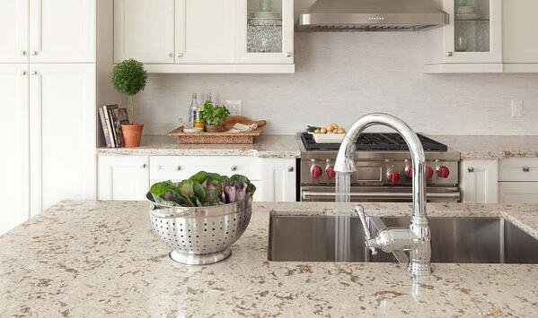 Natural color quartz countertop with white cabinets