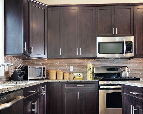 Make Dark Wall Cabinetry Less Intrusive In A Small Kitchen By Using It Only  Along Lower Wall Sections.