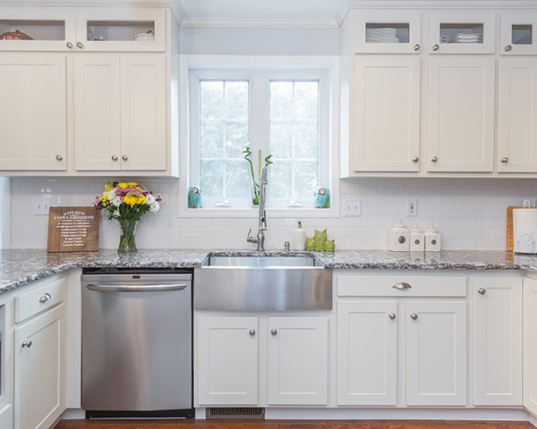 Stainless Steel Cabinet Hardware In A White Kitchen