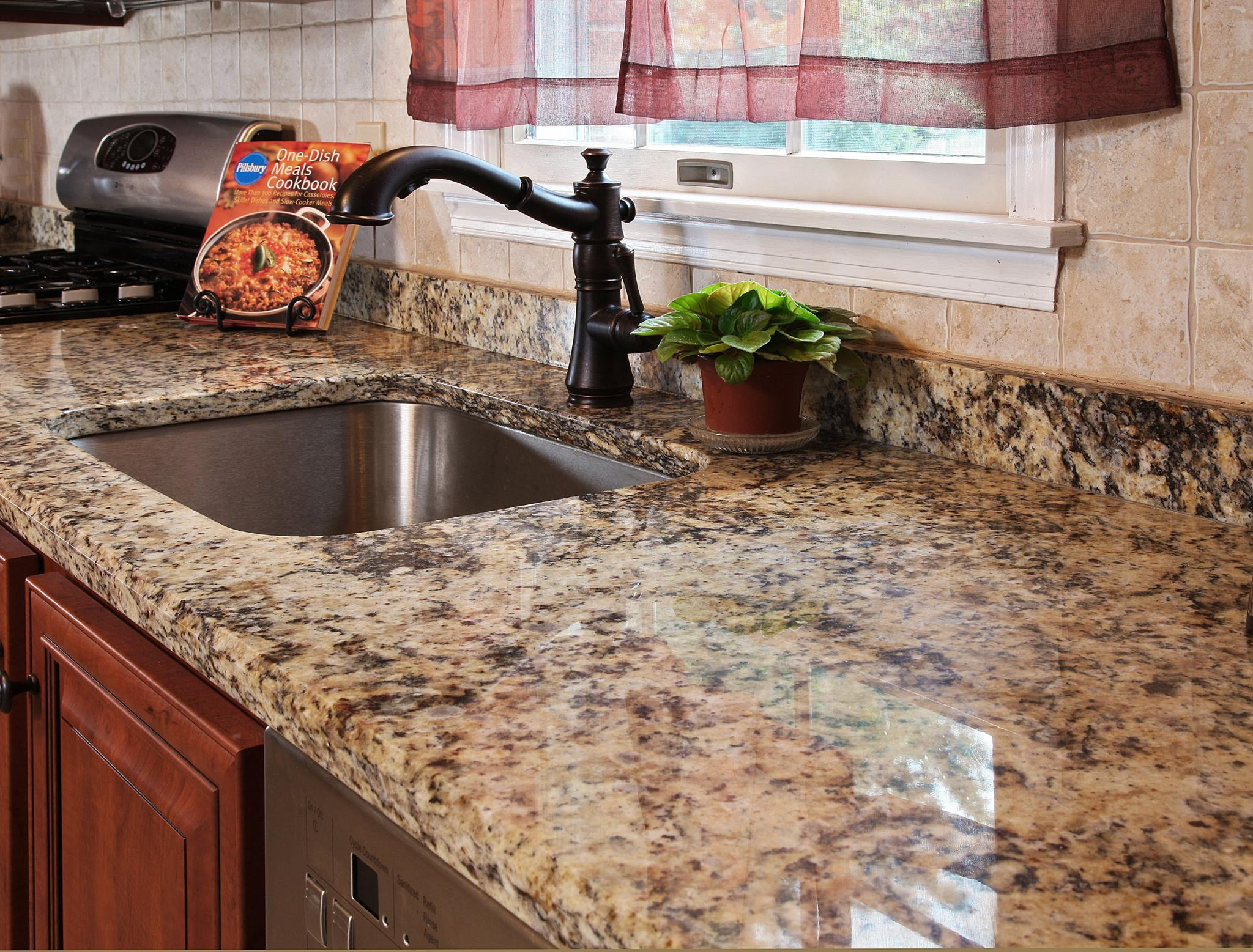 Stunning Granite Countertop in a Classic Cherry Kitchen