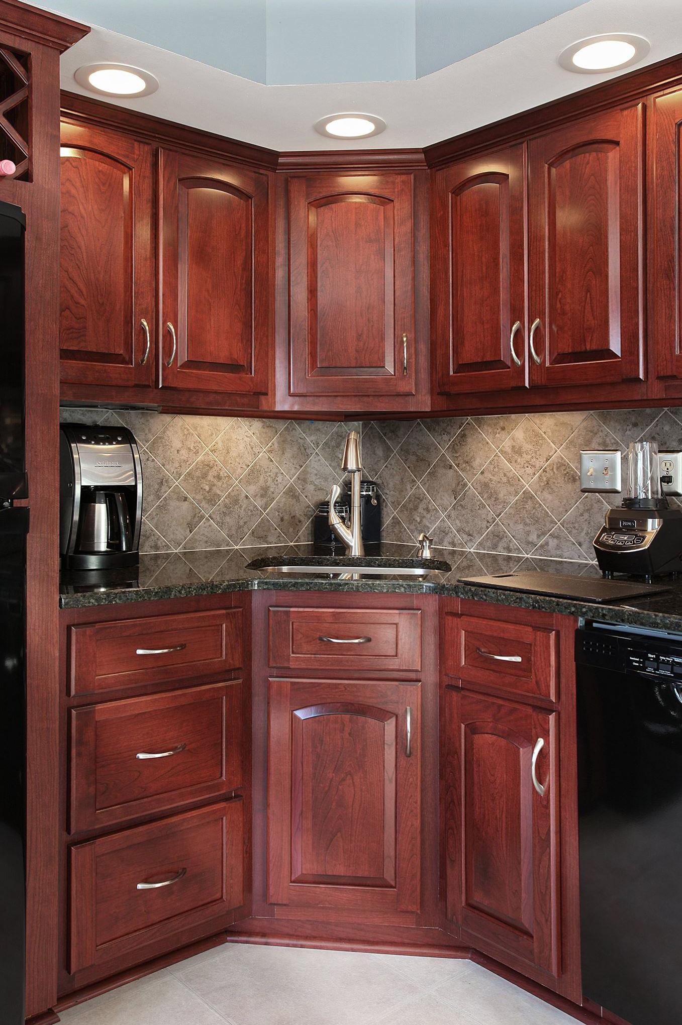 Cordovan Cherry Cabinets Paired With A Uba Tuba Granite Countertop